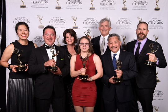 Seattle Channel staff pose with awards at the Northwest Emmy Awards ceremony.