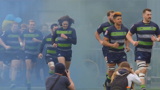 Seattle Seawolves rugby players running on the field