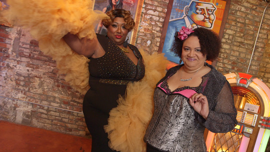 Mx. Pucks A'Plenty and Rebecca Mmm Davis, founders of What the Funk burlesque festival, pose on the set of Art Zone.