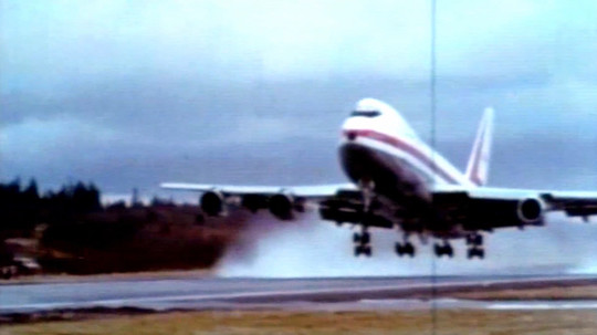 A vintage photo of a Boeing 747 preparing for takeoff.