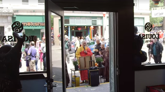 A view looking to the street from inside The Louisa Hotel lobby.