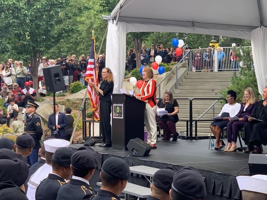 Photo of Mayor Durkan speaking to the crowd at the naturalization ceremony