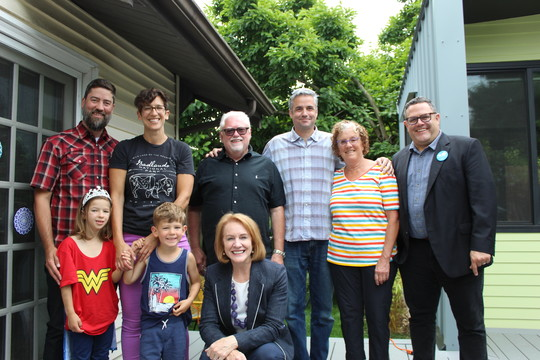 Mayor Durkan poses with multi-generational family and housing advocates at ADU/DADU signing