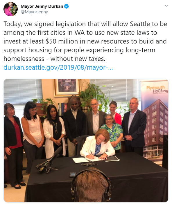 Screenshot of Mayor Durkan's twitter, featuring a photo of her signing the Local Option legislation.