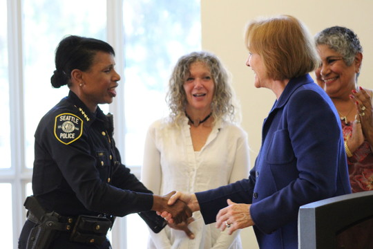 Mayor Durkan and Chief Best shake hands during SPD recruitment and retention press conference