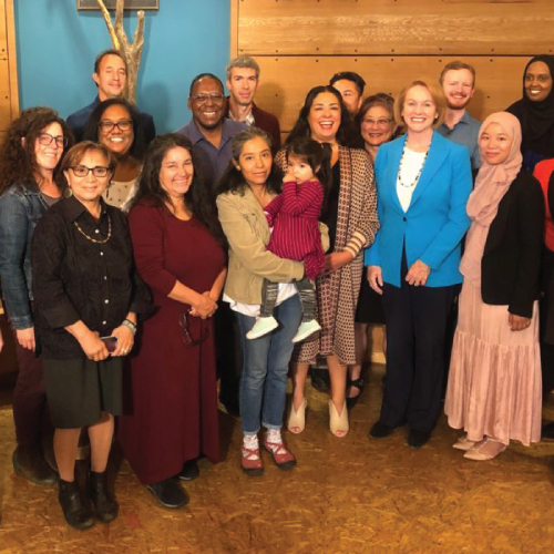 community members posing with Mayor Jenny Durkan