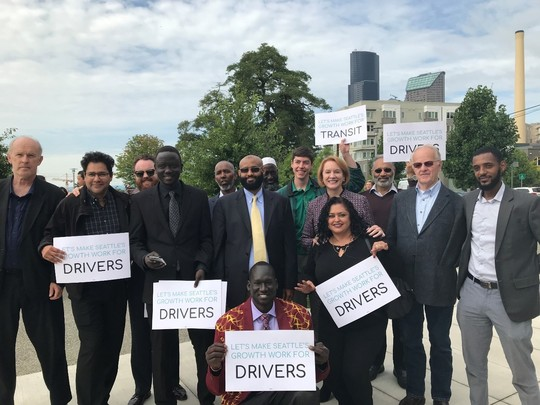 Drivers, transit advocates, and labor supporters stand with Mayor Durkan at the announcement of her Fare Share plan