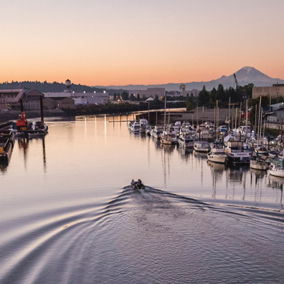 boat on the Duwamish River with Mt Rainier in the distance