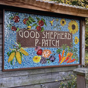 """mosaic tile artwork featuring images of fruits, flowers, vegetables and the words """"Good Shepherd P-Patch"""""""