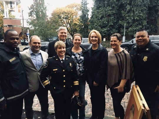 Mayor Durkan poses with Chief Harold Scoggins and leaders from both SPD and SFD on a community walk in Ballard