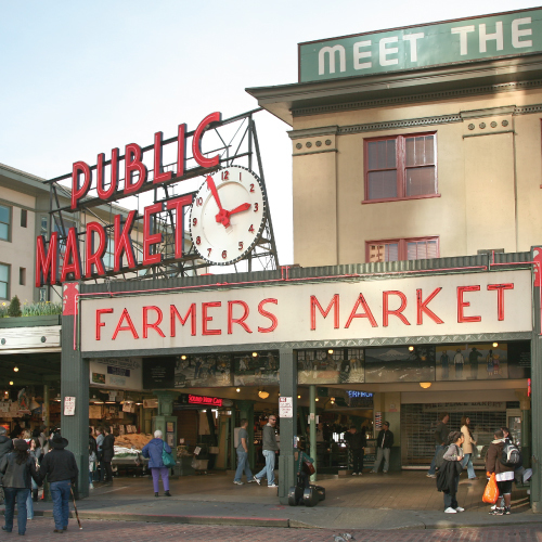 public market sign and clock at Pike Place Market