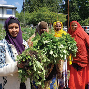 gardeners showing their produce