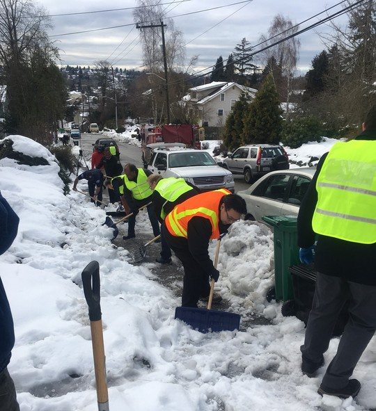 Senior Deputy Mayor Fong and members of Mayor Durkan's cabinet shovel snow as part of 2019's Shared Shovel campaign.