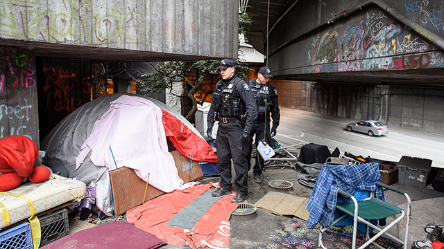 Officials clean up a homeless camp