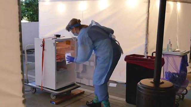 A worker handles coronavirus