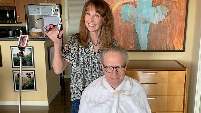 Art Zone's Nancy Guppy prepares to give Joe Guppy a haircut