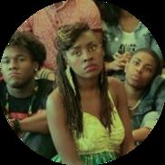 African American woman listening to public speaker