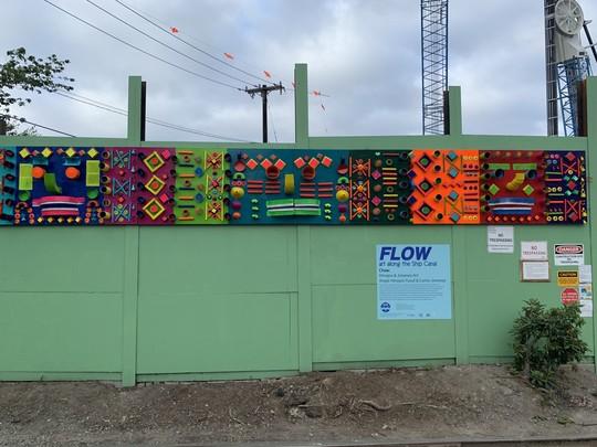 Photo showing temporary art installed on the Ballard screen wall.
