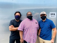 Community Court program leaders Curtis, Naikia and Sokpul standing together wearing masks