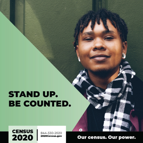 """person smiling, with text that says """"Stand up. Be Counted."""""""