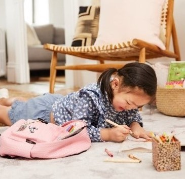 Child learning on floor at home