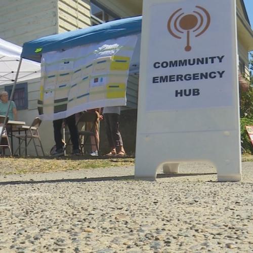 """sandwich board that says """"Community Emergency Hub"""""""