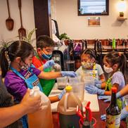Children in a kitchen cooking