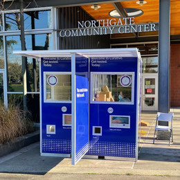 Photo of a walk up testing kiosk in front of a community center