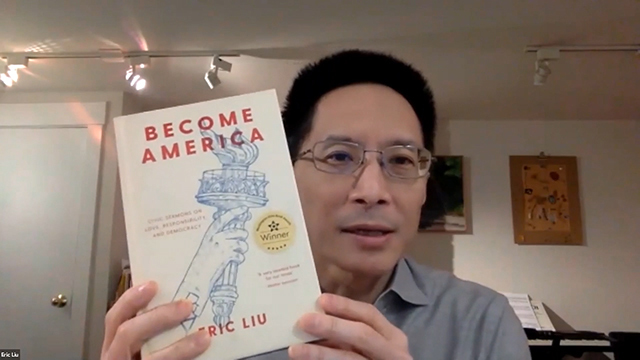 """Eric Liu holds up his book """"Become America"""""""