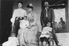 Black and white photo of the Cayton family on their front porch