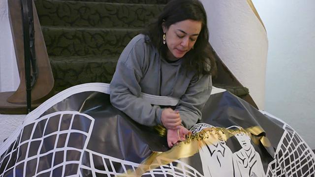 Lauren Iida repairs damaged murals with gold wire
