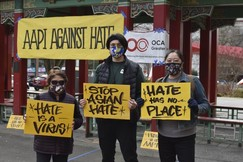 Protesters in Seattle's Chinatown-International District hold signs condemning anti-Asian hate crimes