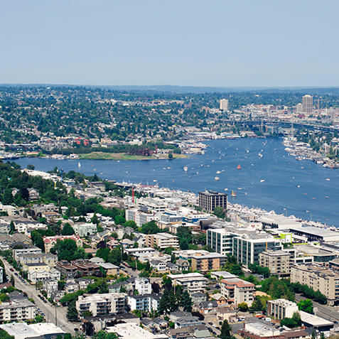 An aerial shot of Lake Union and apartment buildings along the west shoreline.