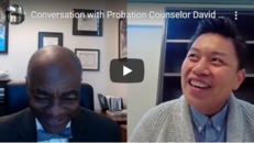 Screenshot of video with Judge Gregory and David Saelee talking