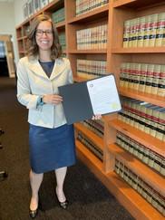 Meg McCann holding her confirmation document