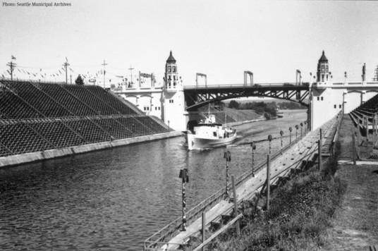 Historical photo of the Montlake Bridge with temporary bleachers in 1936