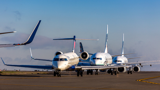 Sea-Tac Airport Planes on taxiway await takeoff