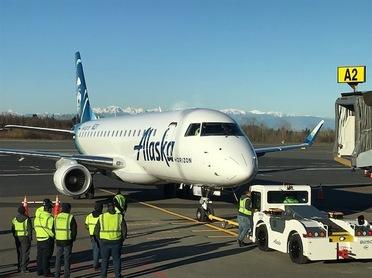 First Flight Jet Sitting at Terminal
