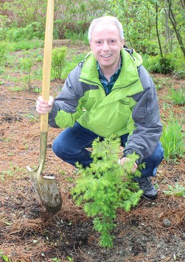 Chair Ryan planting a tree