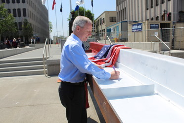 Chair Ryan Signing Document at last beam