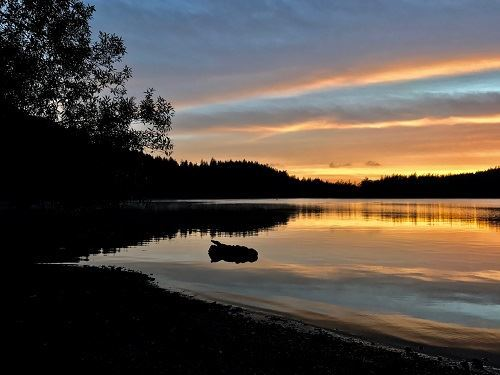 Photograph of sunset over water