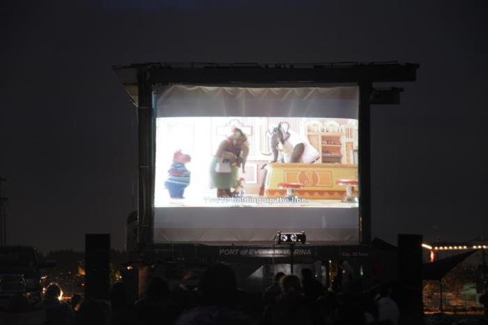 Movie being shown on projector screen.