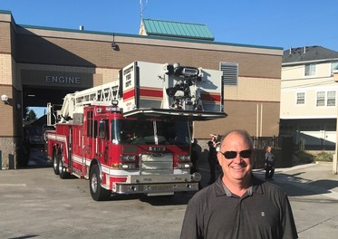 Councilmember Sullivan with the brand new ladder truck at Everett Station 1