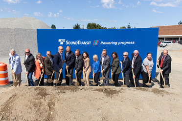 Photo of officials shoveling dirt at groundbreaking