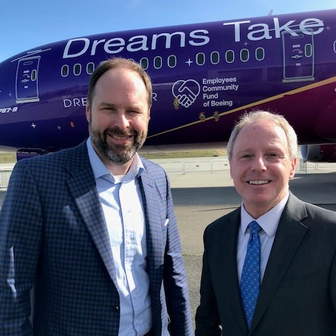 Photo of Bill McSherry and Chair Ryan in front of Boeing plane