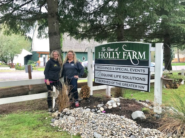 Photo of Holly Winters and Karmel Ackerman in front of Farm Sign