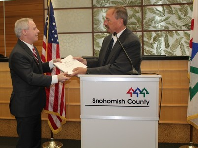 Photo of Executive Somers handing budget to Chair Ryan