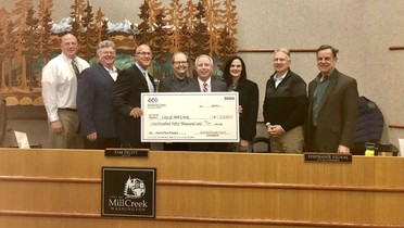 Photo of Chair Ryan presenting check at Mill Creek City Hall