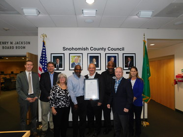 Photo of Gipson's family receiving Resolution from Council