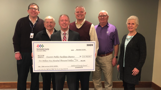 Check presentation with Angel of the Winds Arena